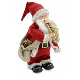 Toy Santa Claus. Santa Claus doll with saxophone. Isolated on a white background royalty free stock images
