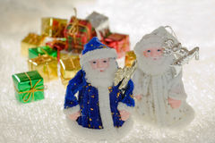 Toy santa claus and gift. Royalty Free Stock Photography