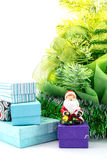 Toy Santa Claus with gifts near a Christmas tree new year isolated Stock Photography