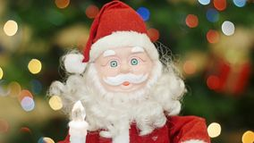Toy Santa Claus greetings at background bokeh stock video