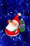 Toy Santa Claus in lamé blu Fotografia Stock Libera da Diritti