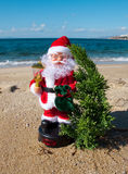 Toy Santa Claus with a New Year tree and gifts stock photos