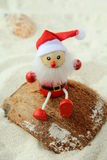 Toy Santa Claus On Sand Beach Royalty Free Stock Images
