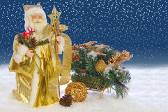 Toy Santa claus and sledges Royalty Free Stock Image