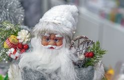 Toy Santa Claus in the store of Christmas gifts and decorations stock photo