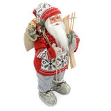 Toy Santa Claus. Unique toy santa claus whit skis whit a bag full of gifts, white background royalty free stock photography