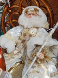 A toy Santa Claus on a wooden chair. Christmas toys background. Christmas toys background. September, 2013 royalty free stock images