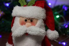 Toy santa clause with lights on the background. Winter is coming. Holiday mood. stock images
