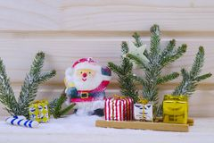 Toy Santa among fir trees and presents Stock Photography