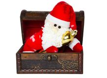 Toy santa klaus in an antiquarian chest Stock Photography