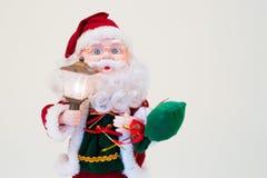 Toy Santa Klaus. With a lantern stock photo
