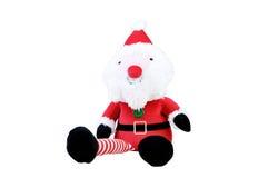 Toy Santa que senta-se no fundo branco Fotos de Stock Royalty Free