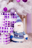 Toy Santa under the Christmas tree Royalty Free Stock Image