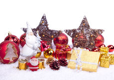Toy santa with xmas ornaments Stock Photos