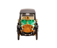 Toy scale model ancient green convertible car. Toy collection scale model ancient green convertible car front view Royalty Free Stock Photography