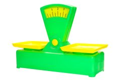 Toy scales. Of colored plastic against white background Royalty Free Stock Image