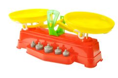 Toy scales with weights. Of colored plastic against white background Stock Photography