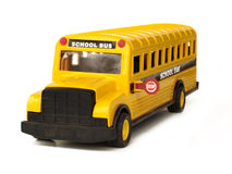 Toy School Bus. 3/4 view of toy school bus with stop sign out Royalty Free Stock Photo