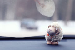 Toy sheep background at car Stock Photography