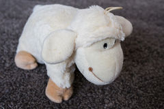Toy sheep. Fluffy white toy sheep. Stock Photo