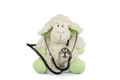 Toy sheep with stethoscope on a white background. Stock Photos