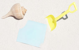 Toy and shell on beach Stock Image