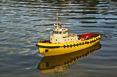 Toy ship. On water like a really liner Stock Photography