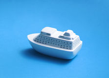 Toy ship on blue background Stock Photography