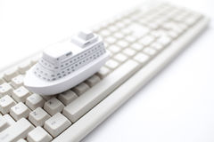 Toy ship on computer keyboard Royalty Free Stock Photos