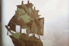 Toy ship double exposure Stock Image
