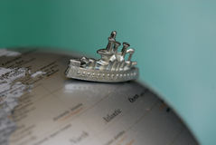 Toy ship on globe Royalty Free Stock Photo