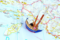 Toy ship and Map. Toy ship on a map. Travelling by ship concept royalty free stock images