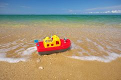 Toy ship on the sea shore. Royalty Free Stock Photos