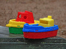 Toy ships. Left in the rain in a children's sandbox Royalty Free Stock Image