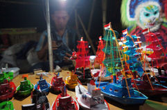 Toy ships. Merchants selling toy ships in the night market in the context of ritual milled sugar factory in Karanganya, Central Java, Indonesia Royalty Free Stock Photography