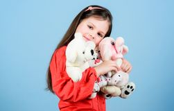Toy shop. childrens day. Best friend. small girl with soft bear toy. child psychology hugging a teddy bear. little girl. Playing game in playroom. happy royalty free stock photo
