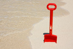 Toy shovel. At the beach Stock Image