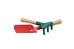 Toy shovel and a rake. Stock Images