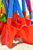 Toy shovel on sand. Colorful shovel in plastic as Kid's toy for playing sand, shown as repeat shape and bright color Royalty Free Stock Images