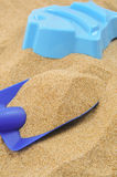 Toy shovel and sand mould Royalty Free Stock Images