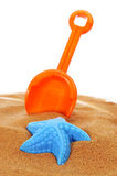 Toy shovel and sand mould Stock Images