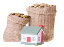 Toy small  house and bags with money. Stock Image