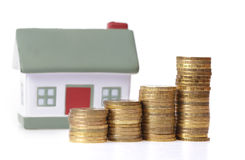 Toy small house and coins Royalty Free Stock Images