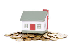 Toy small house and coins Royalty Free Stock Photo