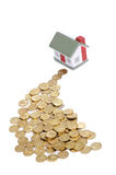 Toy small house and coins Royalty Free Stock Image