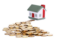 Toy small house and coins Stock Photography