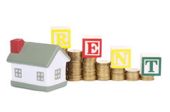 Toy small house and coins in the form of the diagram. concept Royalty Free Stock Image