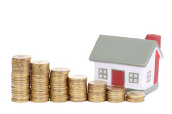 Toy small house and coins in the form of the diagram. concept Stock Image