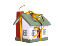 Toy small house with a gold bow. Royalty Free Stock Photography
