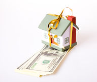 Toy small house with a gold bow. Royalty Free Stock Images